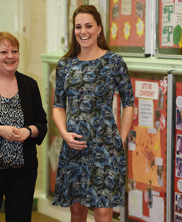 <div class='meta'><div class='origin-logo' data-origin='AP'></div><span class='caption-text' data-credit='AP'>Britain's Kate, Duchess of Cambridge, laughs during her visit to Cape Hill Children's Centre, Smethwick, central England, Wednesday, Feb. 18, 2015.</span></div>