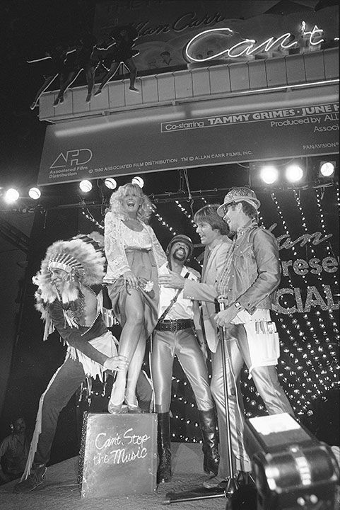<div class='meta'><div class='origin-logo' data-origin='none'></div><span class='caption-text' data-credit='AP Photo/Reed Saxon'>Jenner makes an appearance with the Village People in 1980.</span></div>