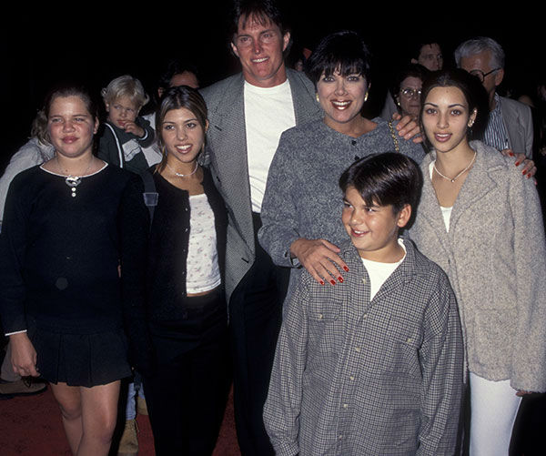 <div class='meta'><div class='origin-logo' data-origin='none'></div><span class='caption-text' data-credit='Getty Photo/Ron Galella, Ltd.'>Jenner and then-wife Kris with Bruce's son, Brandon (front), and Kris' daughters (left to right) Khloe, Kourtney and Kim Kardashian in 1995.</span></div>