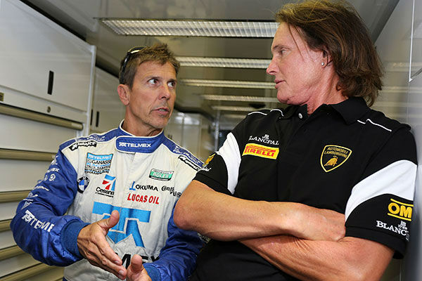 "<div class=""meta image-caption""><div class=""origin-logo origin-image none""><span>none</span></div><span class=""caption-text"">Jenner speaks with race car driver Scott Pruett in 2013. (Getty Photo/Brian Cleary)</span></div>"