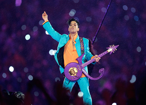 "<div class=""meta image-caption""><div class=""origin-logo origin-image none""><span>none</span></div><span class=""caption-text"">Prince plays a guitar shaped in the symbol used to represent him in his 2007 Super Bowl halftime performance. (Chris O'Meara, File/AP Photo)</span></div>"