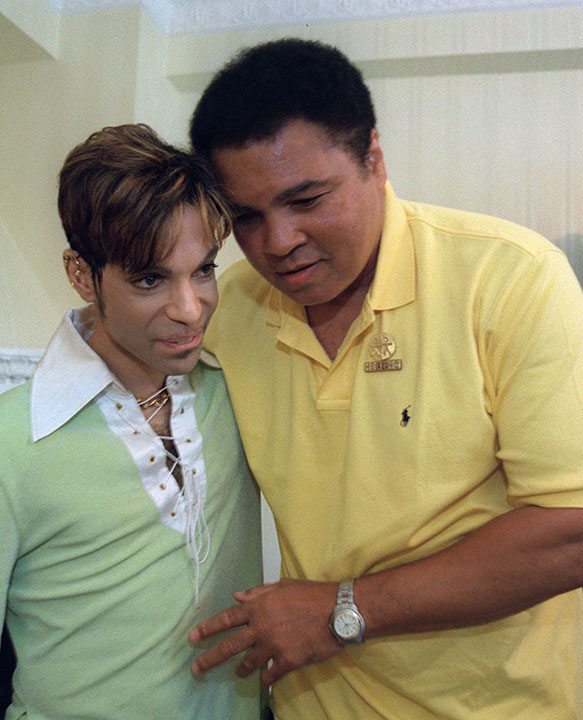 <div class='meta'><div class='origin-logo' data-origin='none'></div><span class='caption-text' data-credit='Karin Cooper/Rogers & Cowan/AP Photo'>Boxing great Muhammad Ali, right, embraces the Artist Formerly Known as Prince, before the pair announced a benefit concert in 1997.</span></div>