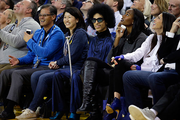 <div class='meta'><div class='origin-logo' data-origin='none'></div><span class='caption-text' data-credit='Marcio Jose Sanchez/AP Photo'>Prince, center, smiles as he watches an NBA basketball game between the Golden State Warriors and the Oklahoma City Thunder on March 3, 2016, in Oakland, Calif.</span></div>
