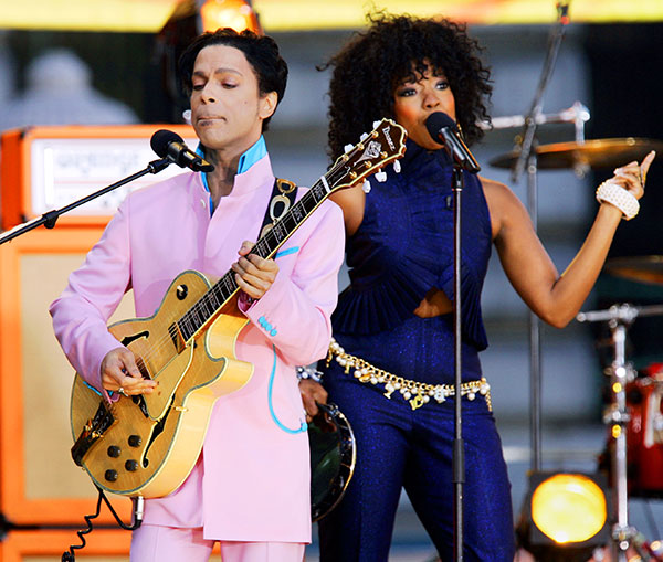<div class='meta'><div class='origin-logo' data-origin='none'></div><span class='caption-text' data-credit='Jeff Christensen/AP Photo'>Prince performs on stage with singer Tamar during ABC's ''Good Morning America'' summer concert series in New York in June 2006.</span></div>