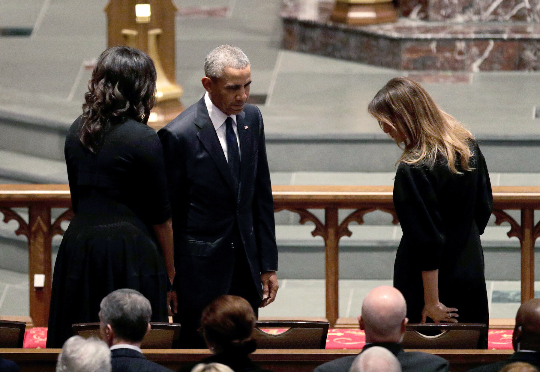 <div class='meta'><div class='origin-logo' data-origin='none'></div><span class='caption-text' data-credit='David J. Phillip-Pool/Getty Images'>Former President Barack Obama and former first lady Michelle Obama greet First Lady Melania Trump at St. Martin's Episcopal Church.</span></div>