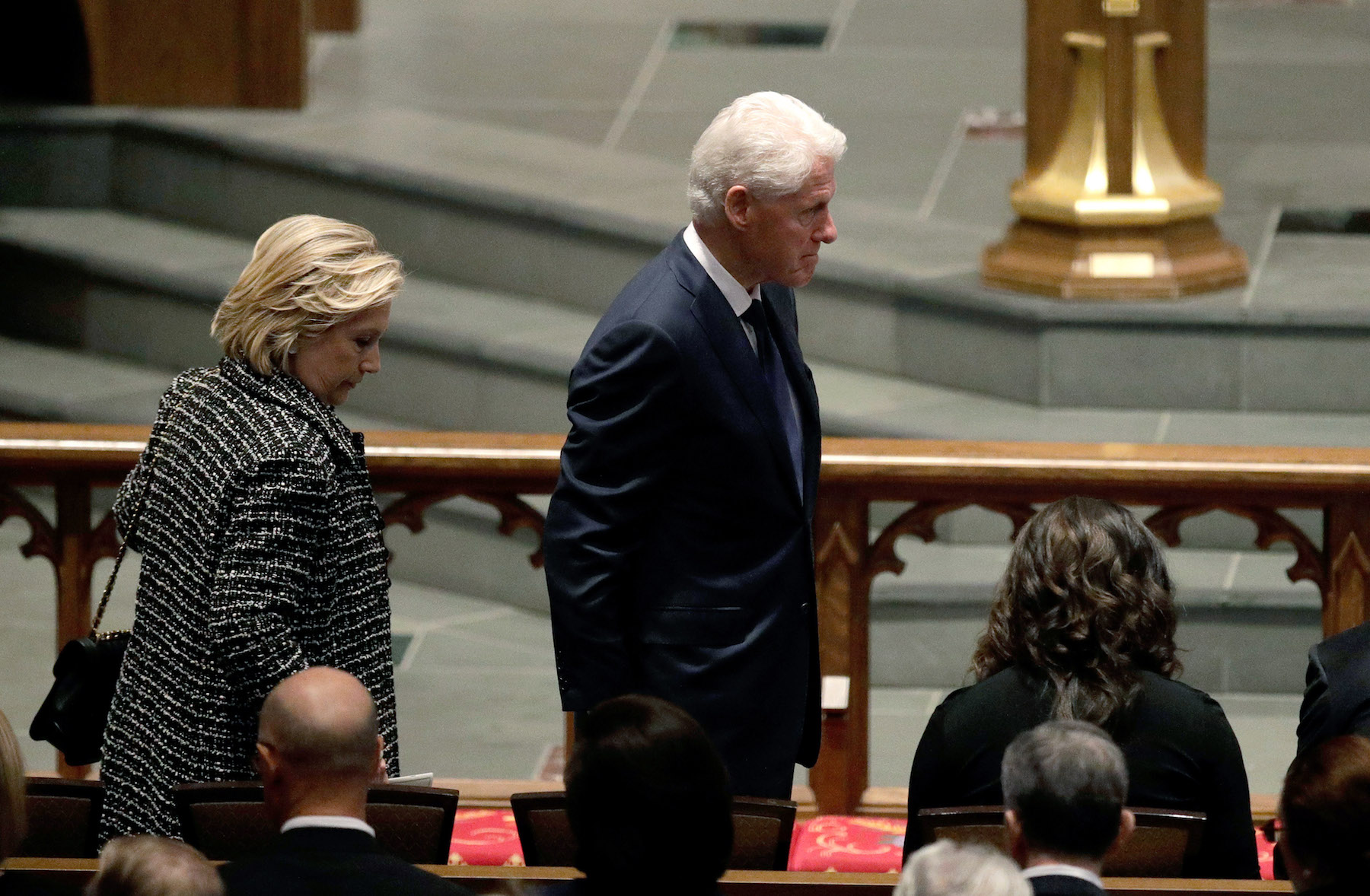 <div class='meta'><div class='origin-logo' data-origin='none'></div><span class='caption-text' data-credit='David J. Phillip-Pool/Getty Images'>Accompanied by his wife, Hillary Clinton,left, former President Bill Clinton arrives at St. Martin's Episcopal Church.</span></div>