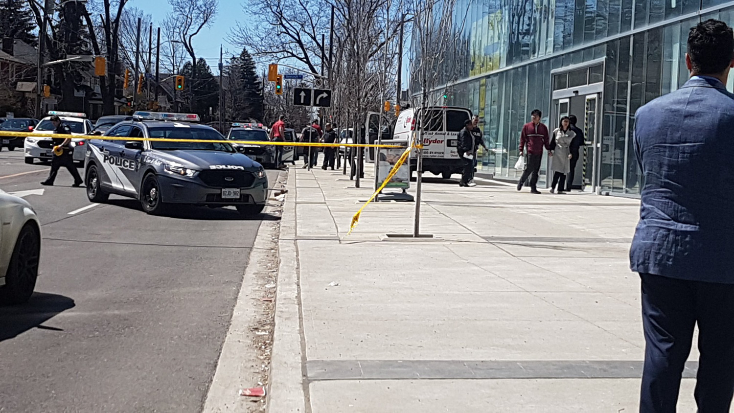 <div class='meta'><div class='origin-logo' data-origin='none'></div><span class='caption-text' data-credit='SophflyPro/Twitter'>A white van hit pedestrians in Toronto, Canada, killing 9 people and injuring 16 more.</span></div>