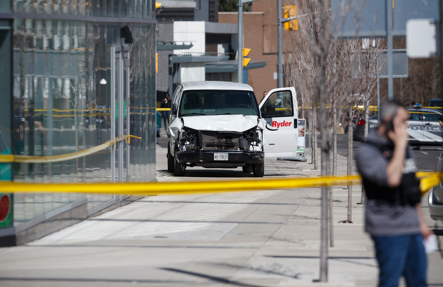 <div class='meta'><div class='origin-logo' data-origin='none'></div><span class='caption-text' data-credit='Cole Burston/Getty Images'>Police inspect a van suspected of being involved in a collision injuring at least eight people at Yonge St. and Finch Ave. on April 23, 2018 in Toronto, Canada</span></div>