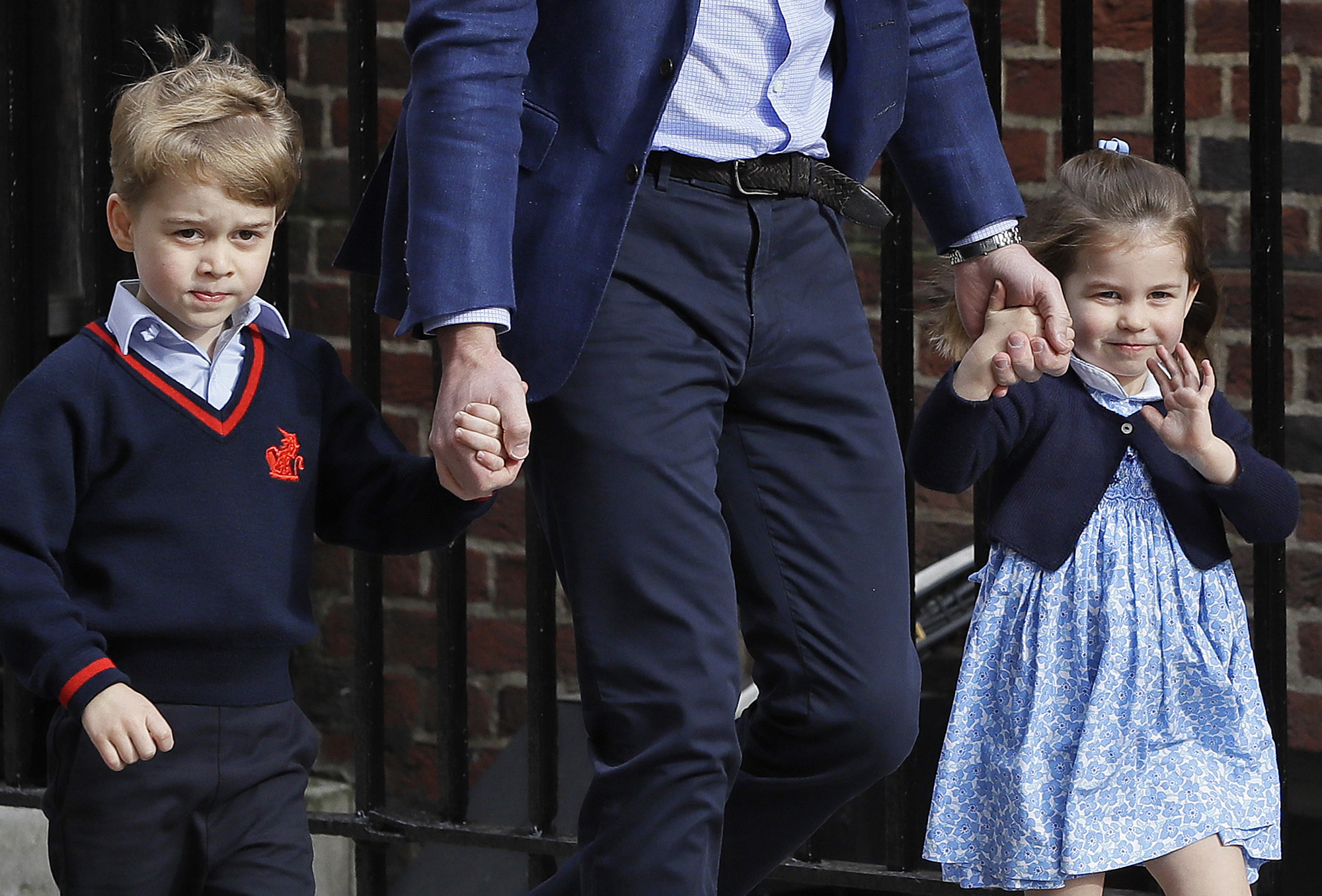 <div class='meta'><div class='origin-logo' data-origin='none'></div><span class='caption-text' data-credit='Kirsty Wigglesworth/AP Photo'>Britain's Prince William arrives with Prince George and Princess Charlotte back to the Lindo wing at St Mary's Hospital in London London, Monday, April 23, 2018.</span></div>