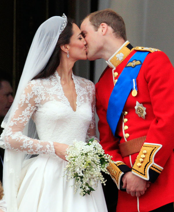 <div class='meta'><div class='origin-logo' data-origin='AP'></div><span class='caption-text' data-credit='AP'>Britain's Prince William kisses his wife Kate, Duchess of Cambridge on the balcony of Buckingham Palace after the Royal Wedding in London Friday, April, 29, 2011.</span></div>