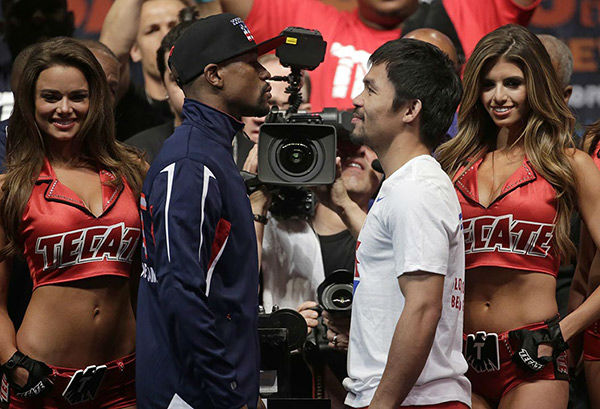<div class='meta'><div class='origin-logo' data-origin='none'></div><span class='caption-text' data-credit='Photo/Chris Carlson'>Photos from the weigh-in for Floyd Mayweather Jr. and Manny Pacquiao on Friday, May 1, 2015 in Las Vegas.</span></div>