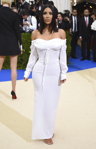 "<div class=""meta image-caption""><div class=""origin-logo origin-image ap""><span>AP</span></div><span class=""caption-text"">Kim Kardashian attends The Met Gala celebrating the opening of the Rei Kawakubo/Comme des Garçons: Art of the In-Between exhibit. (Evan Agostini/Invision/AP)</span></div>"