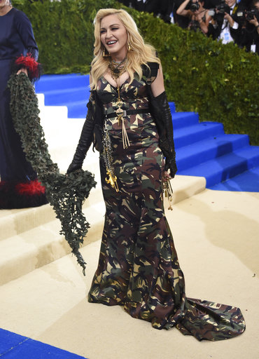 "<div class=""meta image-caption""><div class=""origin-logo origin-image ap""><span>AP</span></div><span class=""caption-text"">Madonna attends The Metropolitan Museum of Art's Costume Institute benefit gala celebrating the opening of the Rei Kawakubo/Comme des Garçons: Art of the In-Between exhibit. (Evan Agostini/Invision/AP)</span></div>"