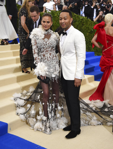 "<div class=""meta image-caption""><div class=""origin-logo origin-image ap""><span>AP</span></div><span class=""caption-text"">Chrissy Teigen, left, and John Legend attends The Met Gala celebrating the opening of the Rei Kawakubo/Comme des Garçons: Art of the In-Between exhibit (Evan Agostini/Invision/AP)</span></div>"