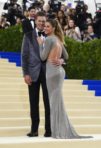 "<div class=""meta image-caption""><div class=""origin-logo origin-image ap""><span>AP</span></div><span class=""caption-text"">Tom Brady, left, and Gisele Bundchen attend The Met Gala celebrating the opening of the Rei Kawakubo/Comme des Garçons: Art of the In-Between exhibit (Evan Agostini/Invision/AP)</span></div>"