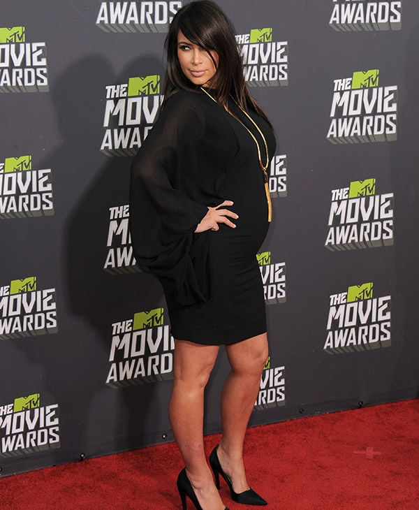 "<div class=""meta image-caption""><div class=""origin-logo origin-image none""><span>none</span></div><span class=""caption-text"">Kim Kardashian arrives at the MTV Movie Awards in Sony Pictures Studio Lot in Culver City, Calif., on Sunday April 14, 2013.  (AP)</span></div>"