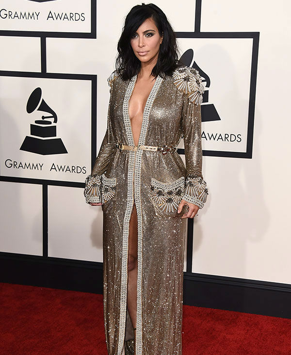 "<div class=""meta image-caption""><div class=""origin-logo origin-image none""><span>none</span></div><span class=""caption-text"">Kim Kardashian arrives at the 57th annual Grammy Awards at the Staples Center on Sunday, Feb. 8, 2015, in Los Angeles.  (AP)</span></div>"