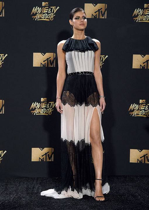 <div class='meta'><div class='origin-logo' data-origin='none'></div><span class='caption-text' data-credit='Richard Shotwell/Invision/AP'>Alexandra Daddario arrives at the MTV Movie and TV Awards at the Shrine Auditorium on Sunday, May 7, 2017, in Los Angeles.</span></div>