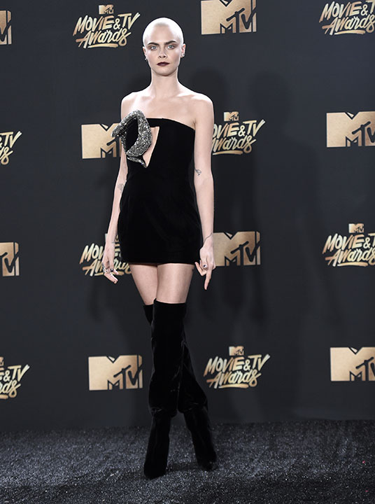 <div class='meta'><div class='origin-logo' data-origin='none'></div><span class='caption-text' data-credit='Richard Shotwell/Invision/AP'>Cara Delevingne arrives at the MTV Movie and TV Awards at the Shrine Auditorium on Sunday, May 7, 2017, in Los Angeles.</span></div>