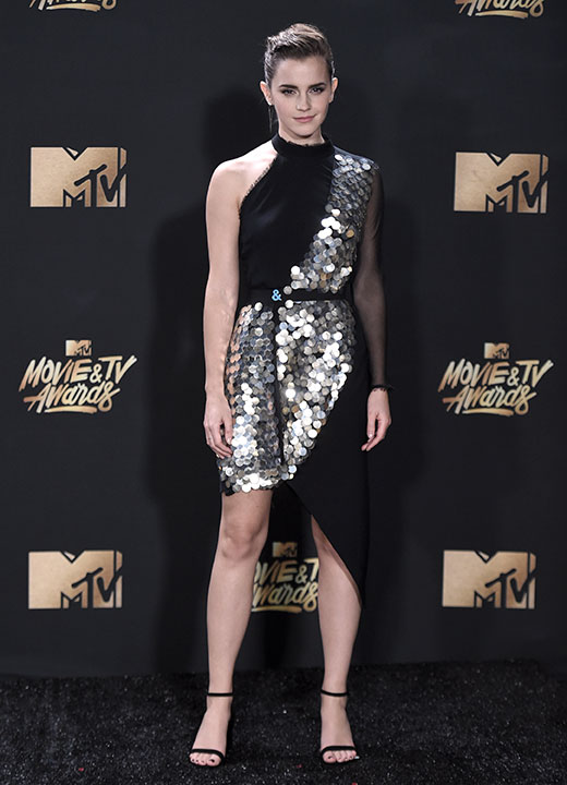 "<div class=""meta image-caption""><div class=""origin-logo origin-image none""><span>none</span></div><span class=""caption-text"">Emma Watson poses in the press room after winning the award for best actor in a movie for ""Beauty and the Beast"" at the MTV Movie and TV Awards at the Shrine Auditorium. (Richard Shotwell/Invision/AP)</span></div>"