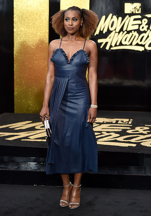 <div class='meta'><div class='origin-logo' data-origin='none'></div><span class='caption-text' data-credit='Jordan Strauss/Invision/AP'>Issa Rae arrives at the MTV Movie and TV Awards at the Shrine Auditorium on Sunday, May 7, 2017, in Los Angeles</span></div>