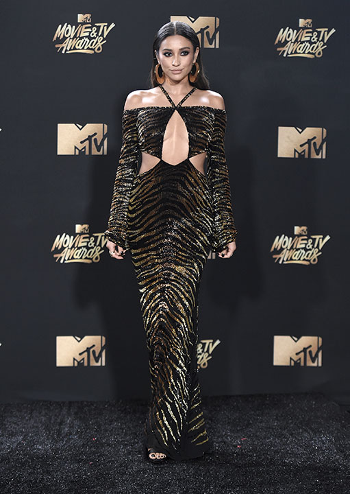 <div class='meta'><div class='origin-logo' data-origin='none'></div><span class='caption-text' data-credit='Richard Shotwell/Invision/AP'>Shay Mitchell arrives at the MTV Movie and TV Awards at the Shrine Auditorium on Sunday, May 7, 2017, in Los Angeles.</span></div>