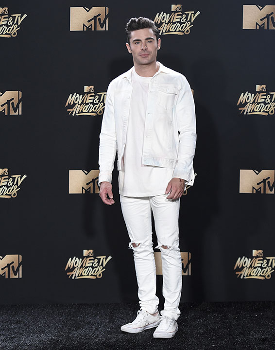 <div class='meta'><div class='origin-logo' data-origin='none'></div><span class='caption-text' data-credit='Richard Shotwell/Invision/AP'>Zac Efron poses in the press room at the MTV Movie and TV Awards at the Shrine Auditorium on Sunday, May 7, 2017, in Los Angeles.</span></div>