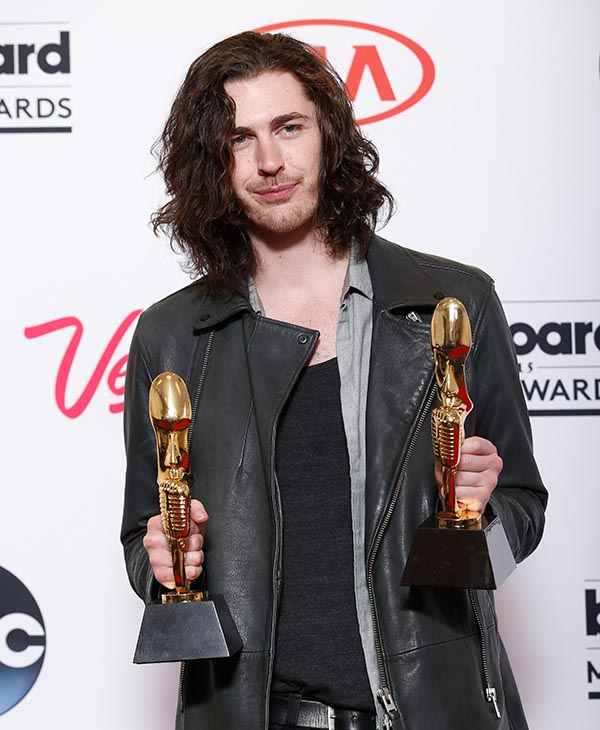 "<div class=""meta image-caption""><div class=""origin-logo origin-image ap""><span>AP</span></div><span class=""caption-text"">Hozier poses in the press room with the awards for top rock artist and top rock song for ""Take Me to Church"" at the Billboard Music Awards at the MGM Grand Garden Arena. (AP)</span></div>"