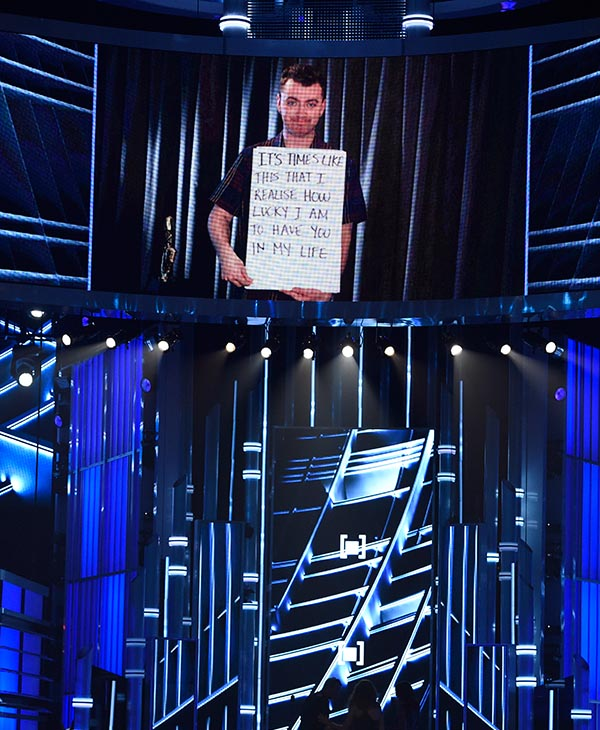 "<div class=""meta image-caption""><div class=""origin-logo origin-image ap""><span>AP</span></div><span class=""caption-text"">Sam Smith is seen on screen accepting the award for top male artist at the Billboard Music Awards at the MGM Grand Garden Arena on Sunday, May 17, 2015, in Las Vegas. (AP)</span></div>"