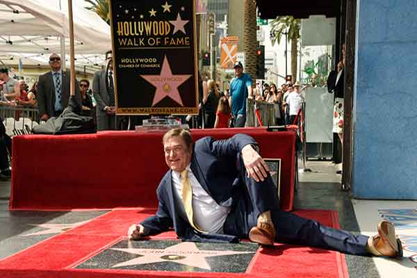 <div class='meta'><div class='origin-logo' data-origin='Creative Content'></div><span class='caption-text' data-credit='Chris Pizzello/Invision/AP'>Actor John Goodman poses behind his new star on the Hollywood Walk of Fame during a ceremony on Friday, March 10, 2017, in Los Angeles.</span></div>