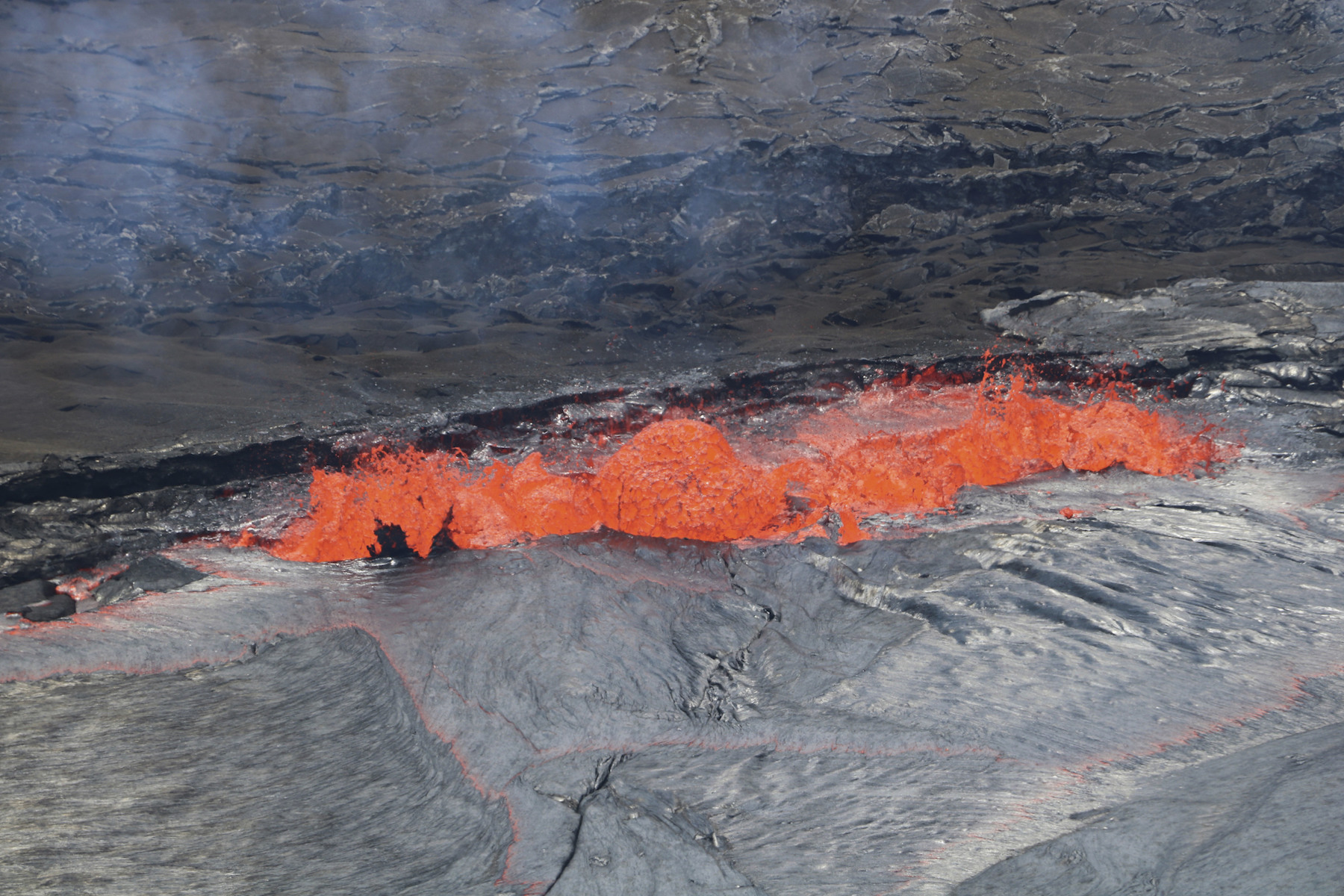 <div class='meta'><div class='origin-logo' data-origin='AP'></div><span class='caption-text' data-credit='USGS/AP'>In this April 22, 2018, photo provided by the U.S. Geological Survey, lava spatters at the edge of Kilauea's Halemaumau Crater in Hawaii Volcanoes National Park.</span></div>