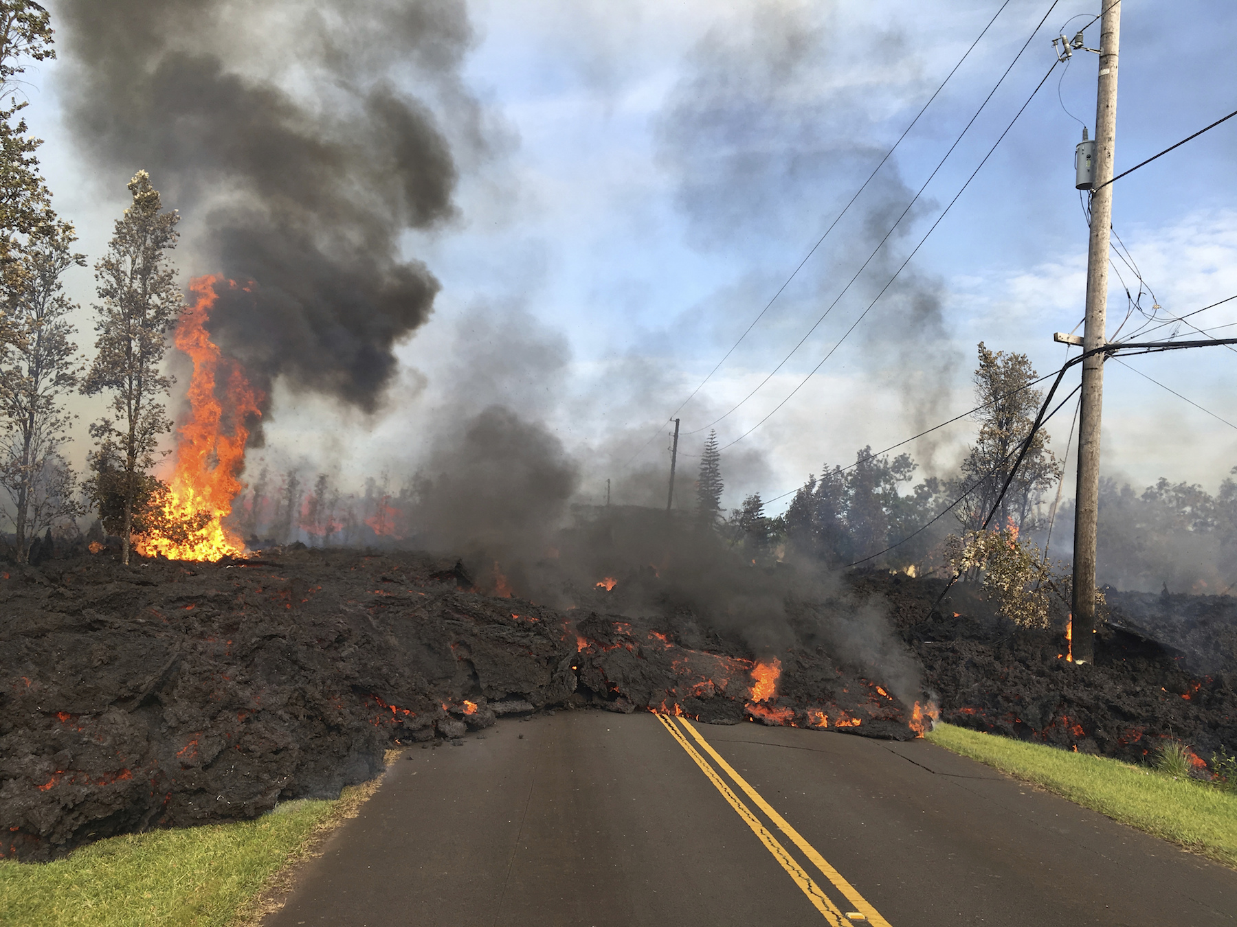 <div class='meta'><div class='origin-logo' data-origin='AP'></div><span class='caption-text' data-credit='USGS/AP'>This Saturday, May 5, 2018, photo shows lava from fissure 7 slowly advancing to the northeast on Hookapu Street in Leilani Estates.</span></div>