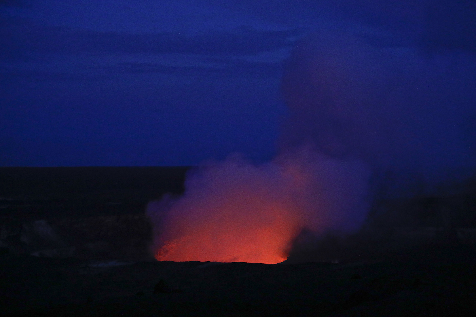 <div class='meta'><div class='origin-logo' data-origin='AP'></div><span class='caption-text' data-credit='AP Photo/Jae C. Hong'>Kilauea's summit crater glows red in Volcanoes National Park, Hawaii. Wednesday, May 9, 2018.</span></div>