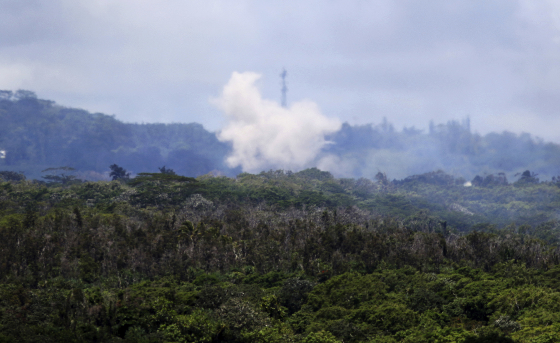<div class='meta'><div class='origin-logo' data-origin='AP'></div><span class='caption-text' data-credit='AP Photo/Caleb Jones'>Volcanic gases and ash rise from recent lava fissures near Pahoa, Hawaii on Monday, May 14, 2018.</span></div>