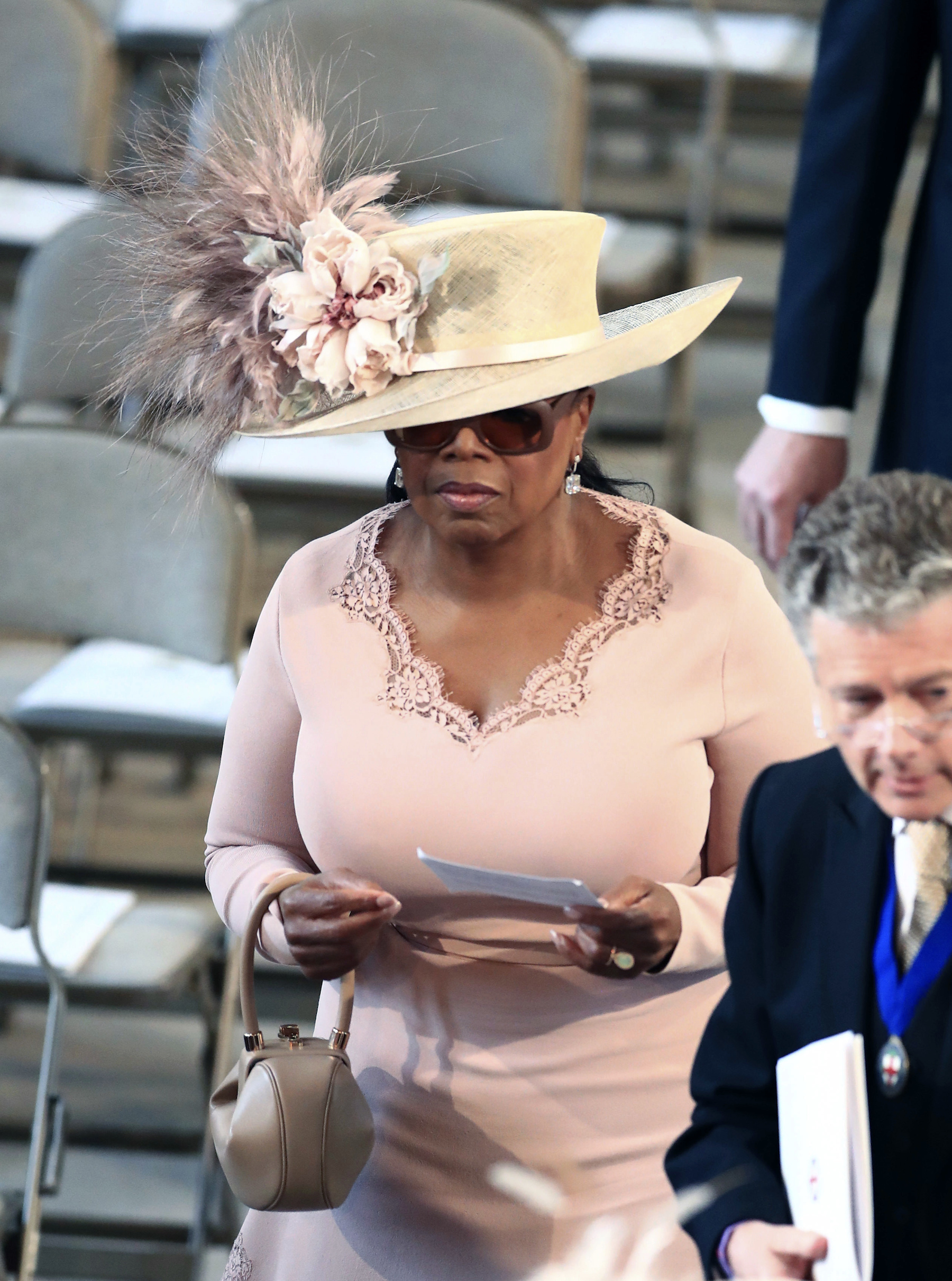 <div class='meta'><div class='origin-logo' data-origin='AP'></div><span class='caption-text' data-credit='Danny Lawson/PA Wire'>Oprah Winfrey arrives in St George's Chapel at Windsor Castle for the wedding of Prince Harry and Meghan Markle.</span></div>