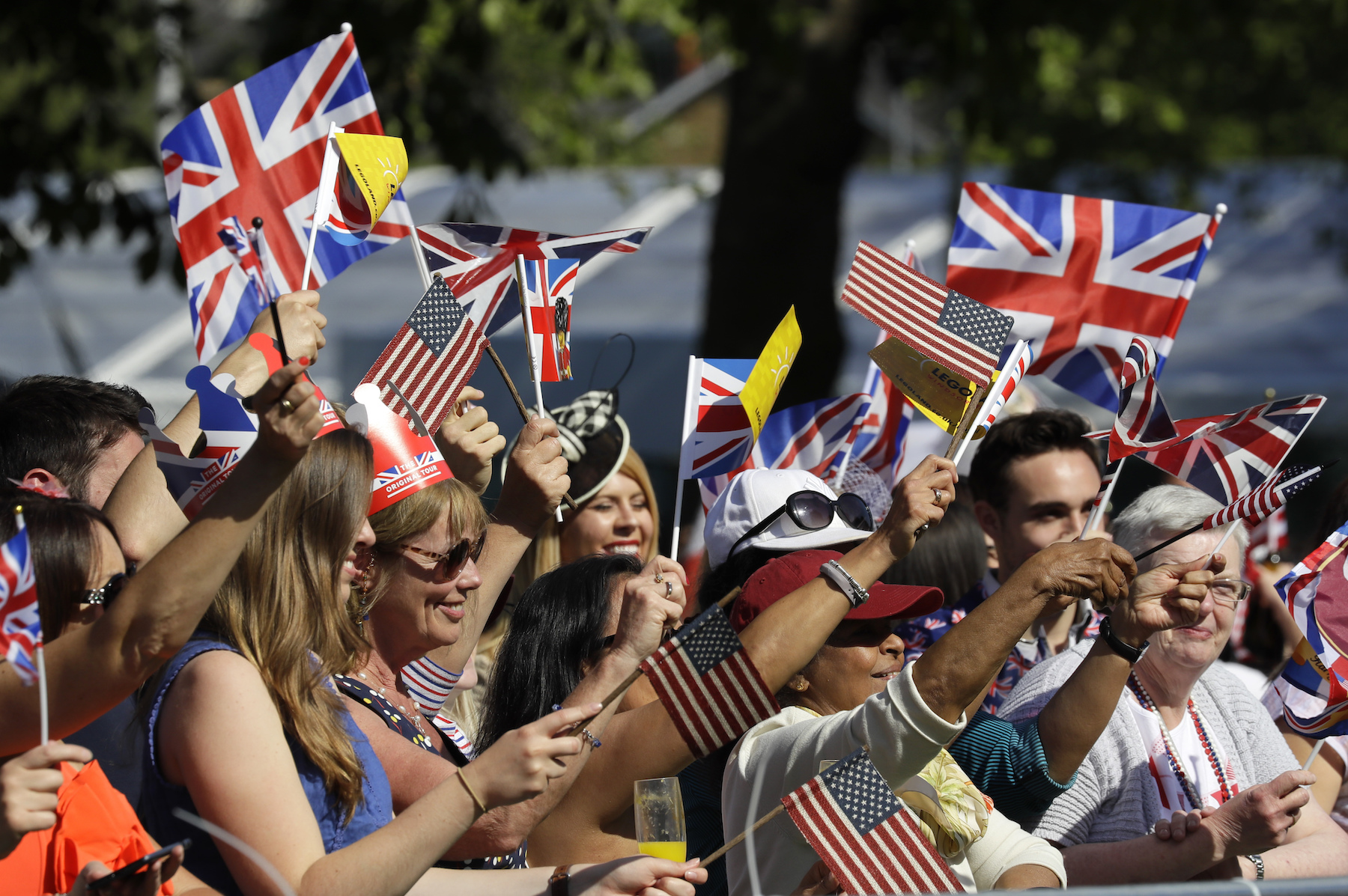<div class='meta'><div class='origin-logo' data-origin='AP'></div><span class='caption-text' data-credit='AP Photo/Kirsty Wigglesworth'>Well-wishers wave British and American flags prior to the wedding ceremony of Prince Harry and Meghan Markle at St. George's Chapel.</span></div>