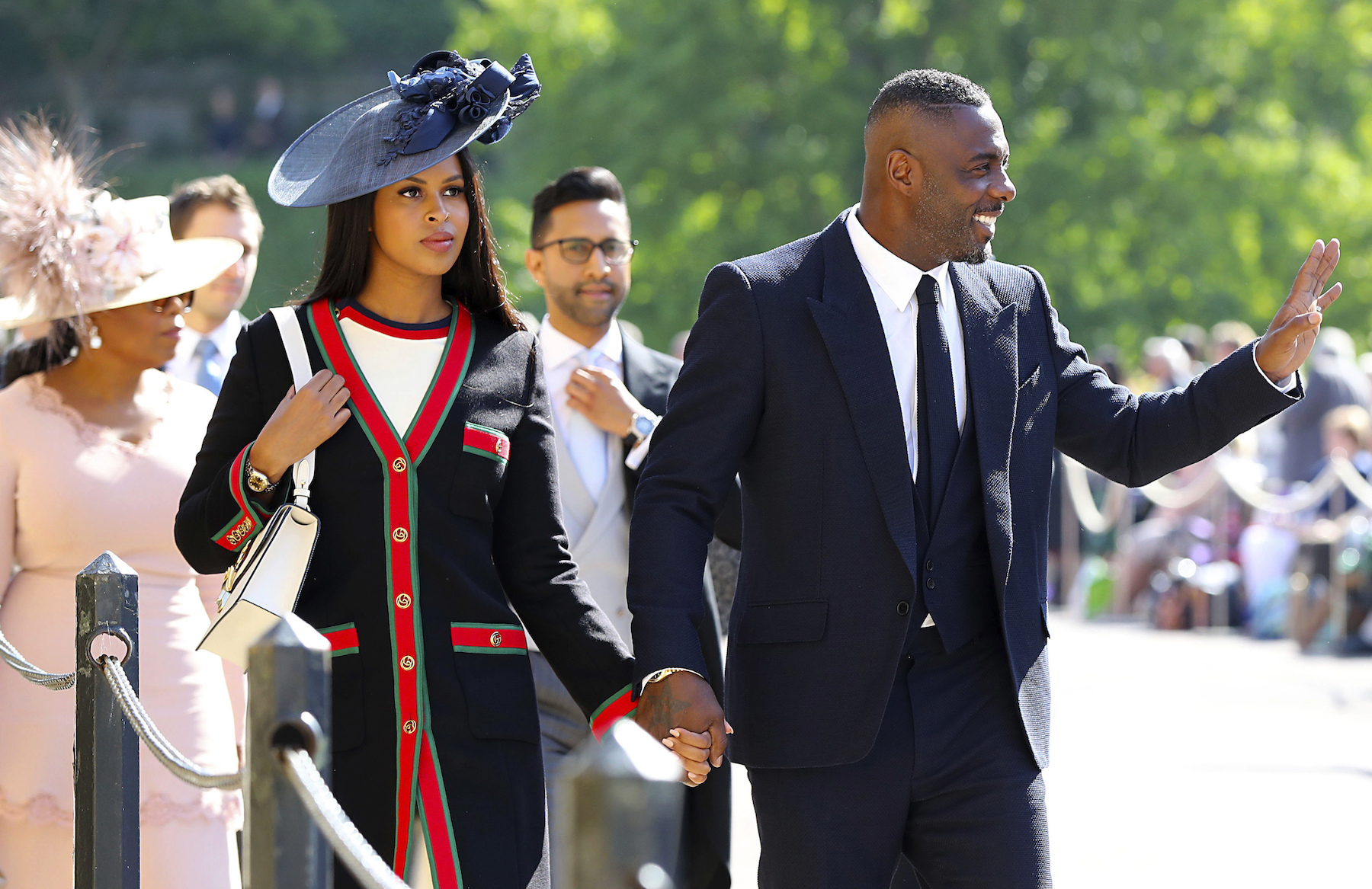 <div class='meta'><div class='origin-logo' data-origin='AP'></div><span class='caption-text' data-credit='Gareth Fuller/PA Wire'>Idris Elba (right) and Sabrina Dhowre arrive at St George's Chapel at Windsor Castle for the wedding of Meghan Markle and Prince Harry.</span></div>