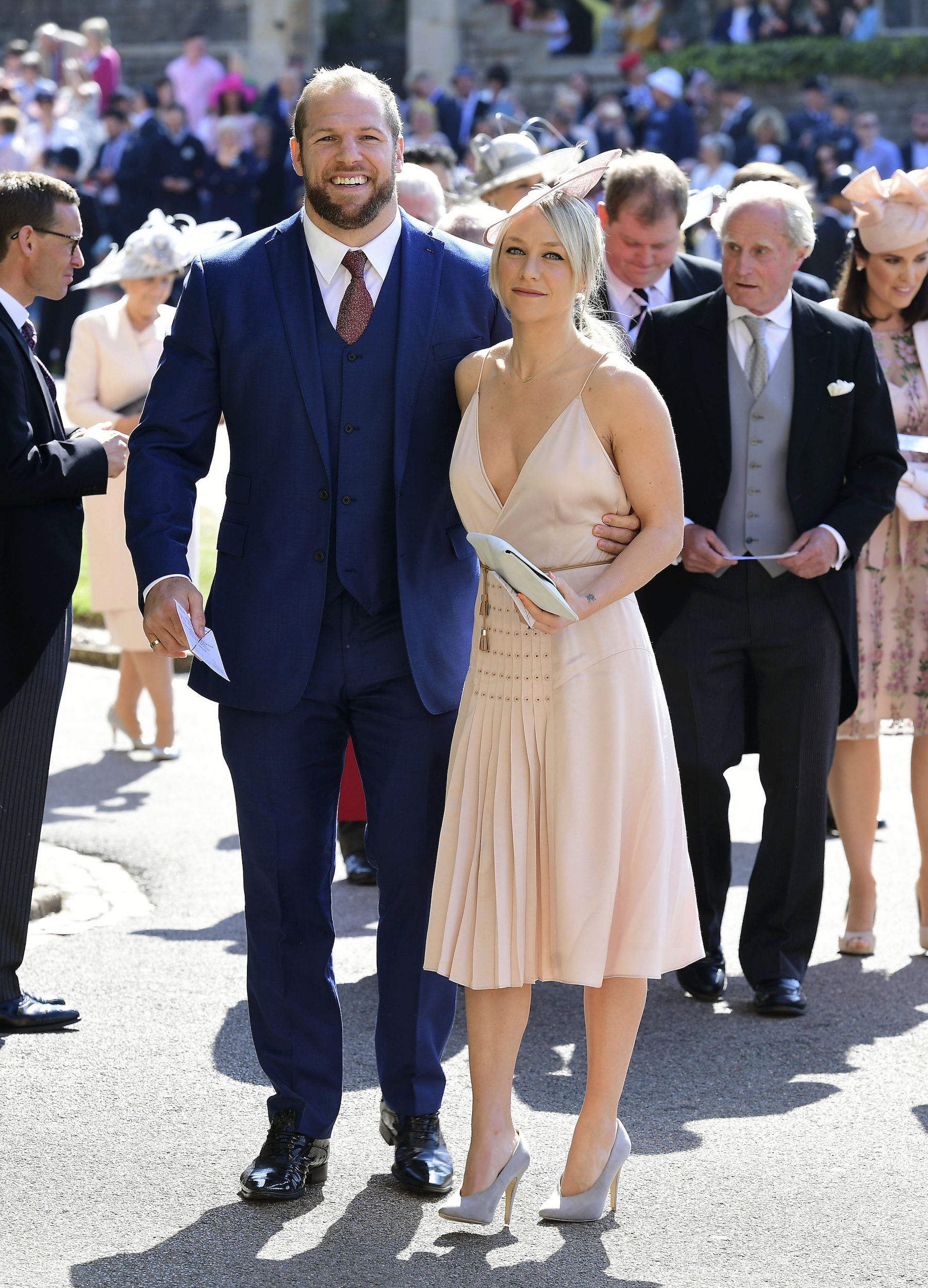 <div class='meta'><div class='origin-logo' data-origin='AP'></div><span class='caption-text' data-credit='Ian West/PA Wire'>James Haskell and Chloe Madeley arrives at St George's Chapel at Windsor Castle for the wedding of Meghan Markle and Prince Harry.</span></div>