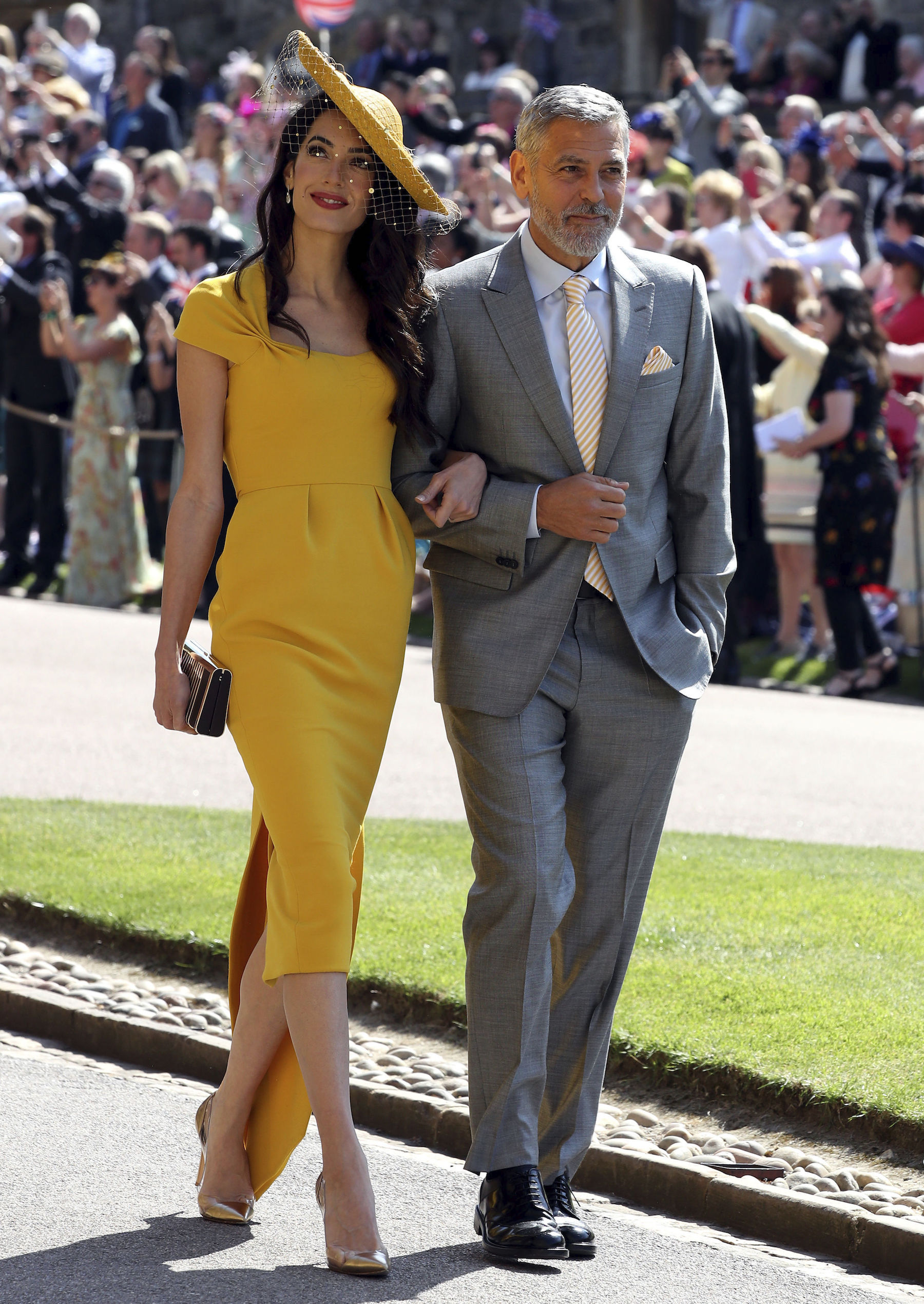 <div class='meta'><div class='origin-logo' data-origin='AP'></div><span class='caption-text' data-credit='Chris Radburn/PA Wire'>George and Amal Clooney arrive at St George's Chapel at Windsor Castle for the wedding of Meghan Markle and Prince Harry.</span></div>