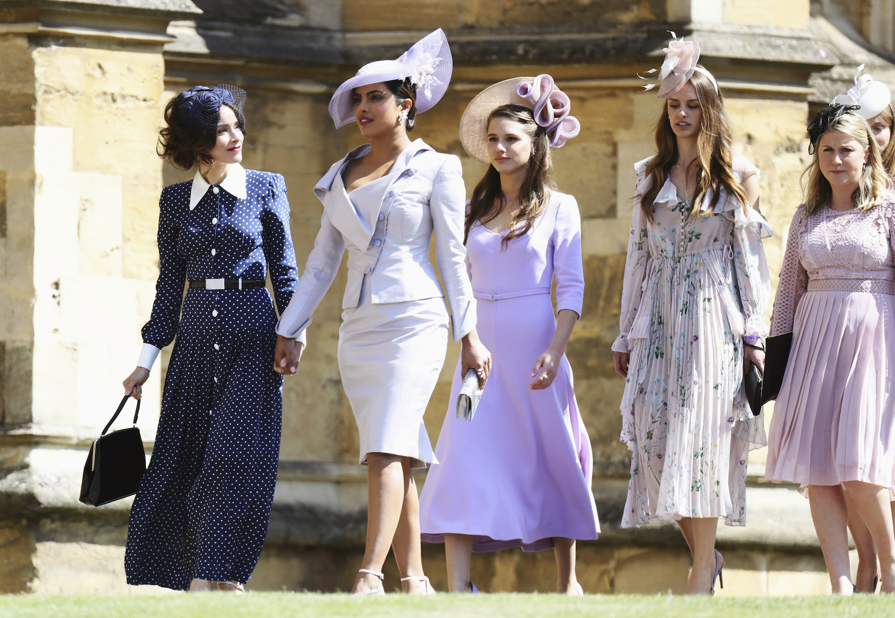 <div class='meta'><div class='origin-logo' data-origin='AP'></div><span class='caption-text' data-credit='Chris Jackson/Getty Images'>Abigail Spencer and Priyanka Chopra arrive at the wedding of Prince Harry to Ms Meghan Markle.</span></div>