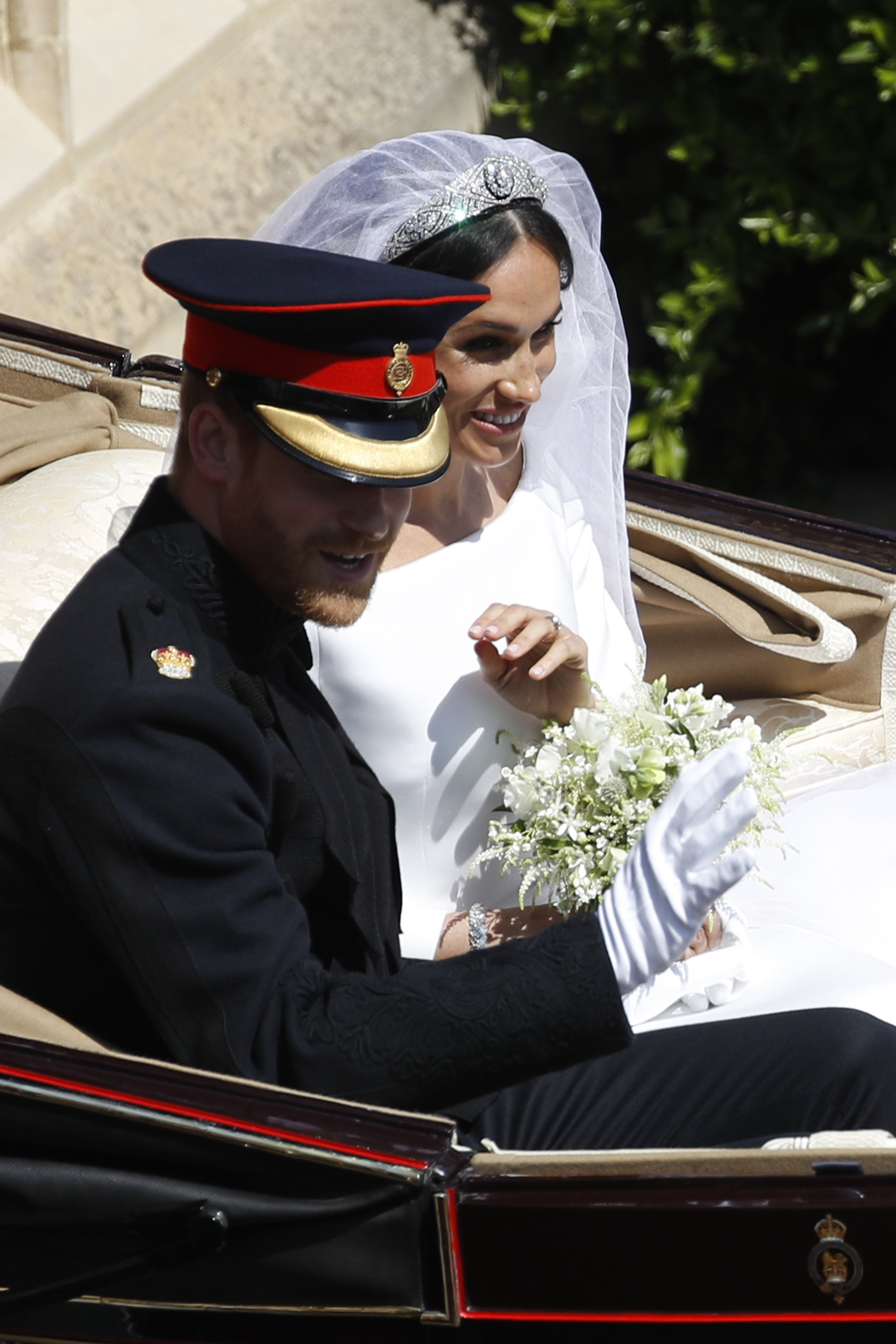 <div class='meta'><div class='origin-logo' data-origin='AP'></div><span class='caption-text' data-credit='Odd Andersen/pool photo via AP'>Britain's Prince Harry and Meghan Markle leave in a carriage after their wedding ceremony at St. George's Chapel in Windsor Castle in Windsor.</span></div>