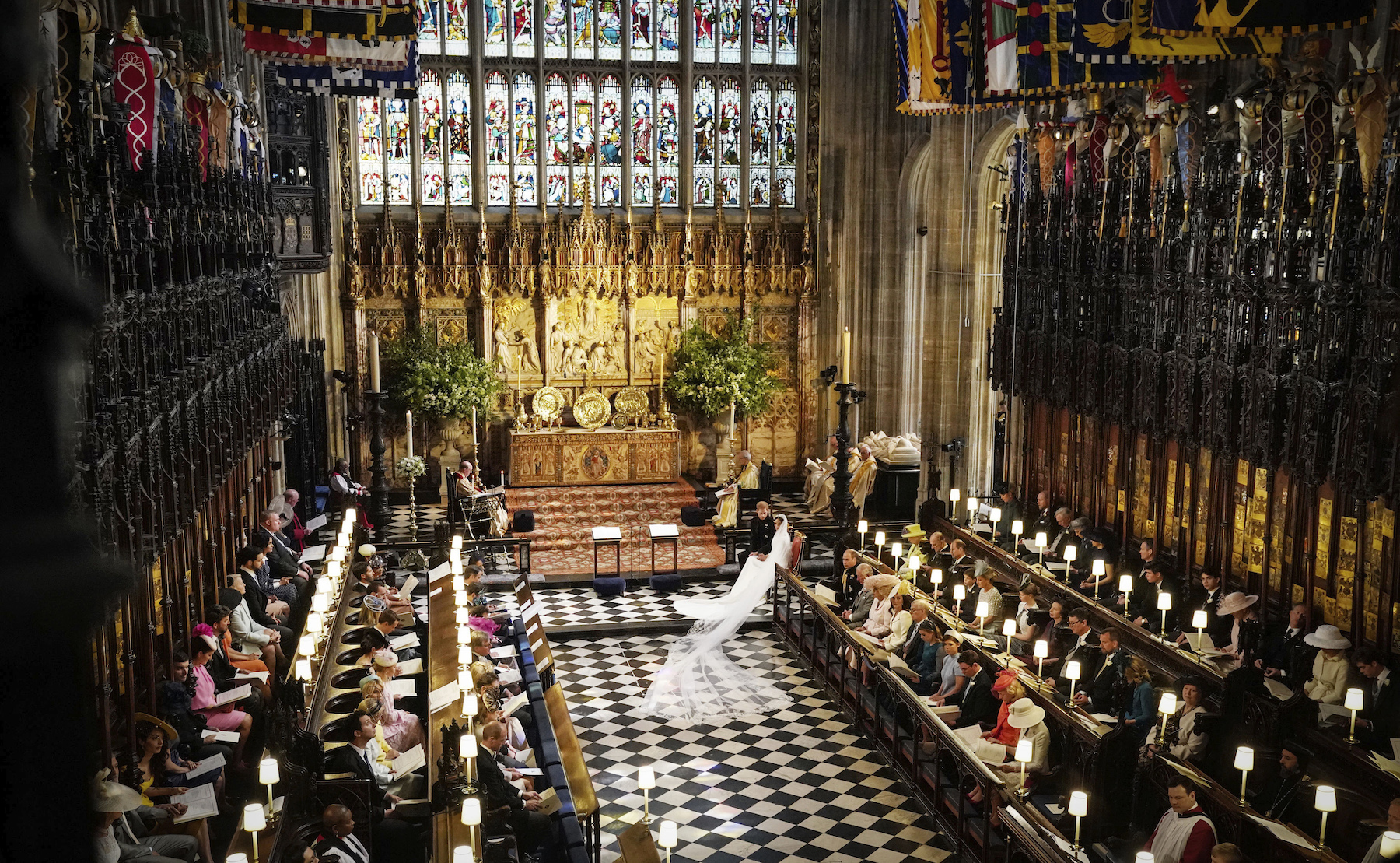 <div class='meta'><div class='origin-logo' data-origin='Creative Content'></div><span class='caption-text' data-credit='Owen Humphreys/PA Wire'>Prince Harry and Meghan Markle in St George's Chapel at Windsor Castle during their wedding service.</span></div>