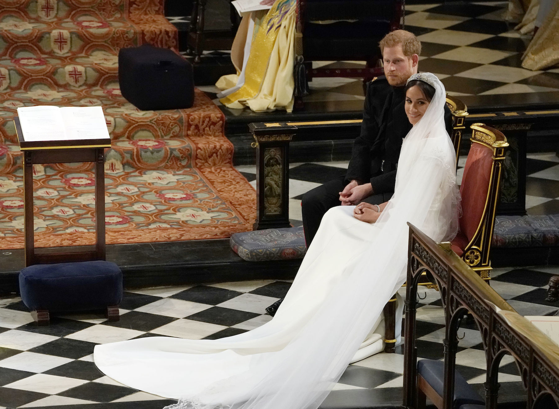 <div class='meta'><div class='origin-logo' data-origin='Creative Content'></div><span class='caption-text' data-credit='Owen Humphreys/AFP/Getty Images'>Britain's Prince Harry, Duke of Sussex (L) sits with US actress Meghan Markle (R) during the reading in St George's Chapel.</span></div>