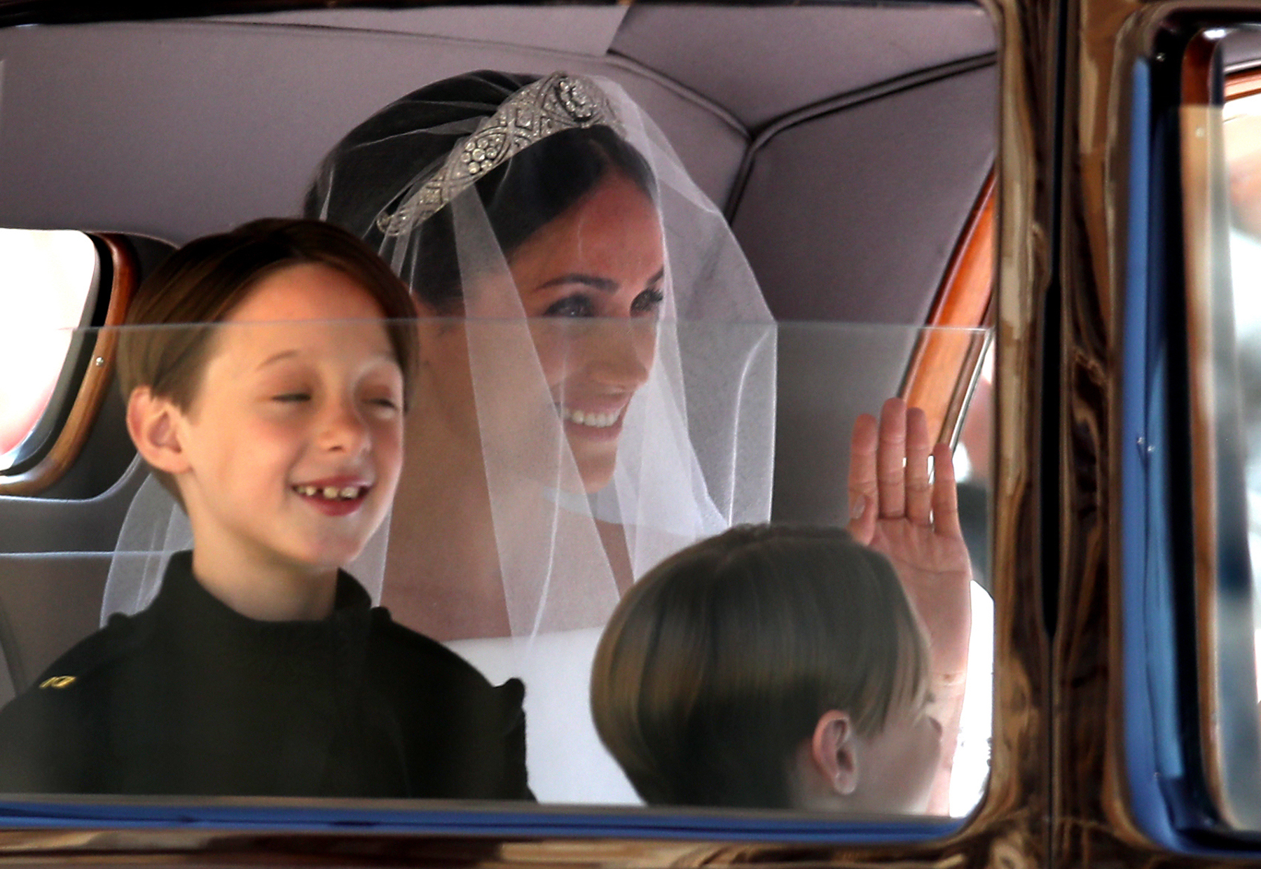 <div class='meta'><div class='origin-logo' data-origin='Creative Content'></div><span class='caption-text' data-credit='Chris Radburn/AFP/Getty Images'>Page boys John and Brian Mulroney accompany US actress Meghan Markle as she arrives in a car for the wedding ceremony to marry Britain's Prince Harry.</span></div>