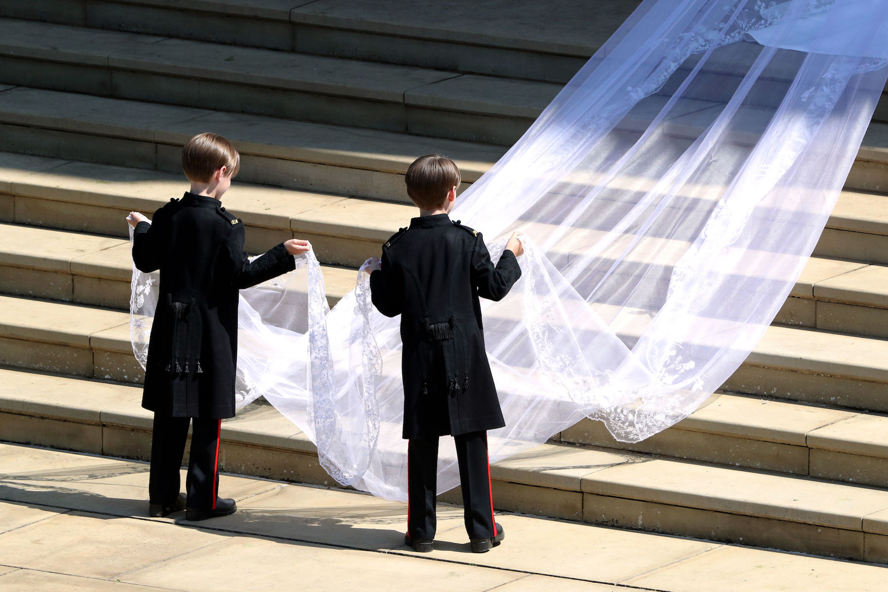 <div class='meta'><div class='origin-logo' data-origin='AP'></div><span class='caption-text' data-credit='Andrew Matthews/AFP/Getty Images'>Page boys John and Brian Mulroney accompany US actress Meghan Markle as she arrives in a car for the wedding ceremony to marry Britain's Prince Harry.</span></div>