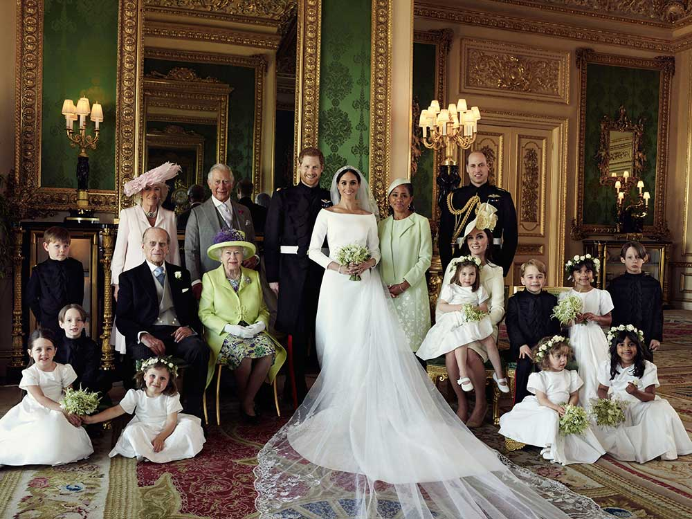 <div class='meta'><div class='origin-logo' data-origin='none'></div><span class='caption-text' data-credit='Alexi Lubomirski/Kensington Palace via AP'>This official wedding photo of Britain's Prince Harry and Meghan Markle shows the bridesmaids, the page boys and the couple's families, including Queen Elizabeth II.</span></div>