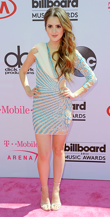 "<div class=""meta image-caption""><div class=""origin-logo origin-image ap""><span>AP</span></div><span class=""caption-text"">Laura Marano arrives at the Billboard Music Awards at the T-Mobile Arena on Sunday, May 22, 2016, in Las Vegas. (Richard Shotwell/Invision/AP)</span></div>"