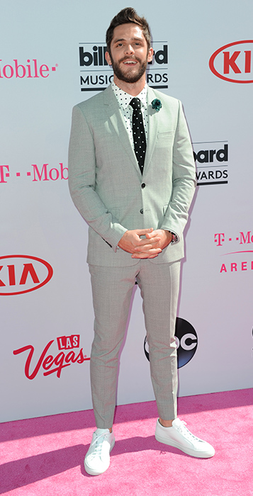 "<div class=""meta image-caption""><div class=""origin-logo origin-image ap""><span>AP</span></div><span class=""caption-text"">Thomas Rhett arrives at the Billboard Music Awards at the T-Mobile Arena on Sunday, May 22, 2016, in Las Vegas. (Richard Shotwell/Invision/AP)</span></div>"