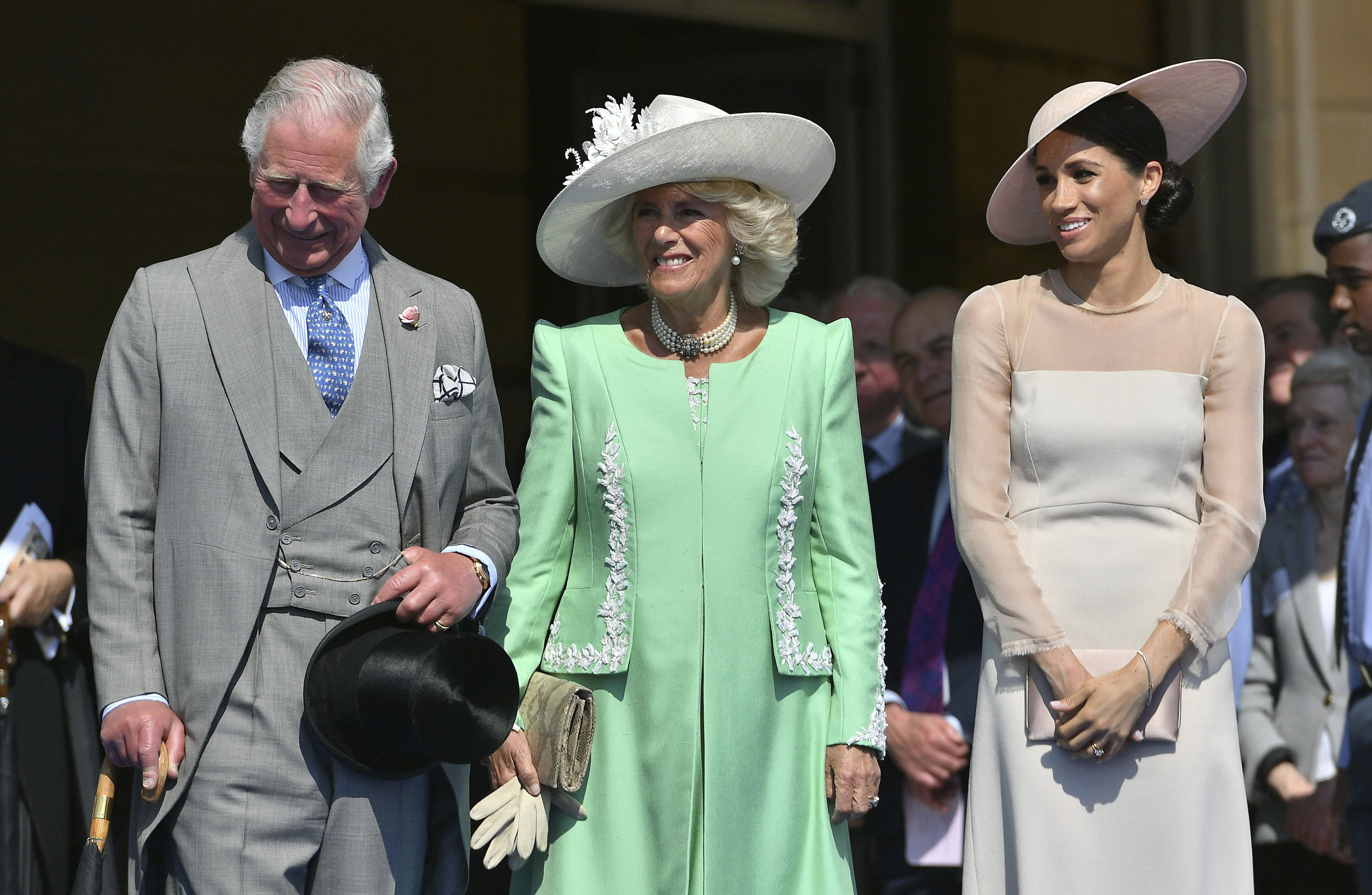 <div class='meta'><div class='origin-logo' data-origin='none'></div><span class='caption-text' data-credit='Dominic Lipinski/Pool Photo via AP'>From left, Britain's Prince Charles, Camilla, the Duchess of Cornwall, and Meghan, the Duchess of Sussex attend a garden party at Buckingham Palace in London, Tuesday May 22, 2018.</span></div>