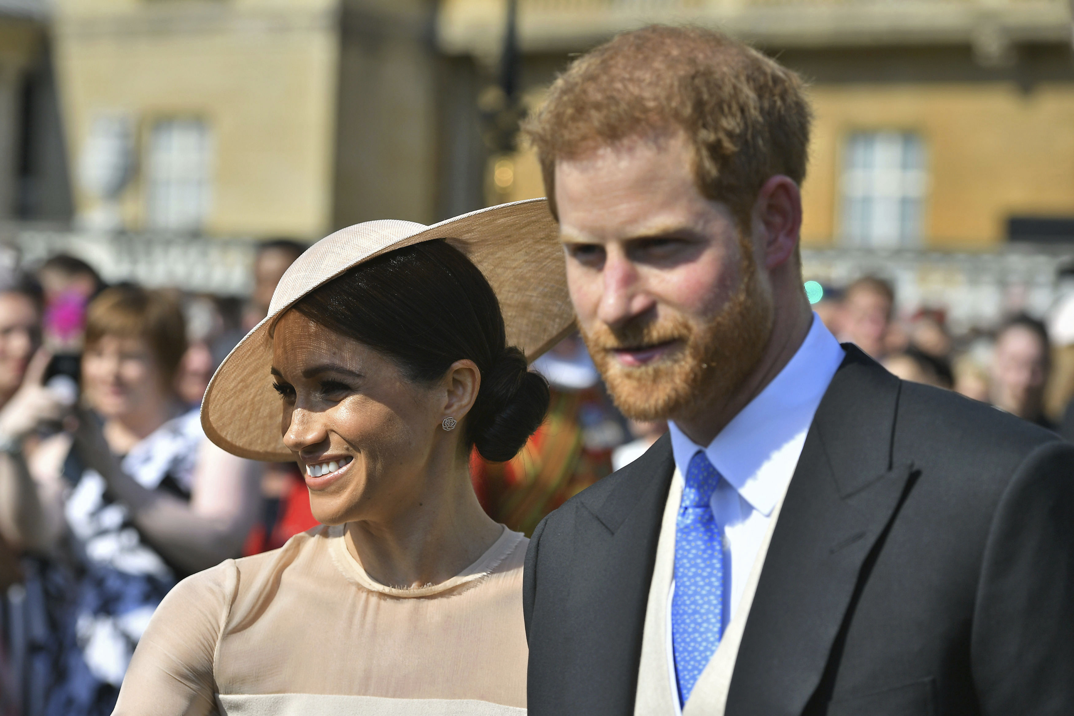 <div class='meta'><div class='origin-logo' data-origin='none'></div><span class='caption-text' data-credit='Dominic Lipinski/Pool Photo via AP'>Meghan, the Duchess of Sussex walks with her husband, Prince Harry as they attend a garden party at Buckingham Palace in London, Tuesday May 22, 2018.</span></div>